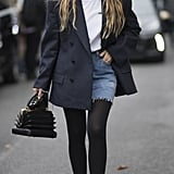 Wear Thick Black Tights With Your Distressed Denim Skirt