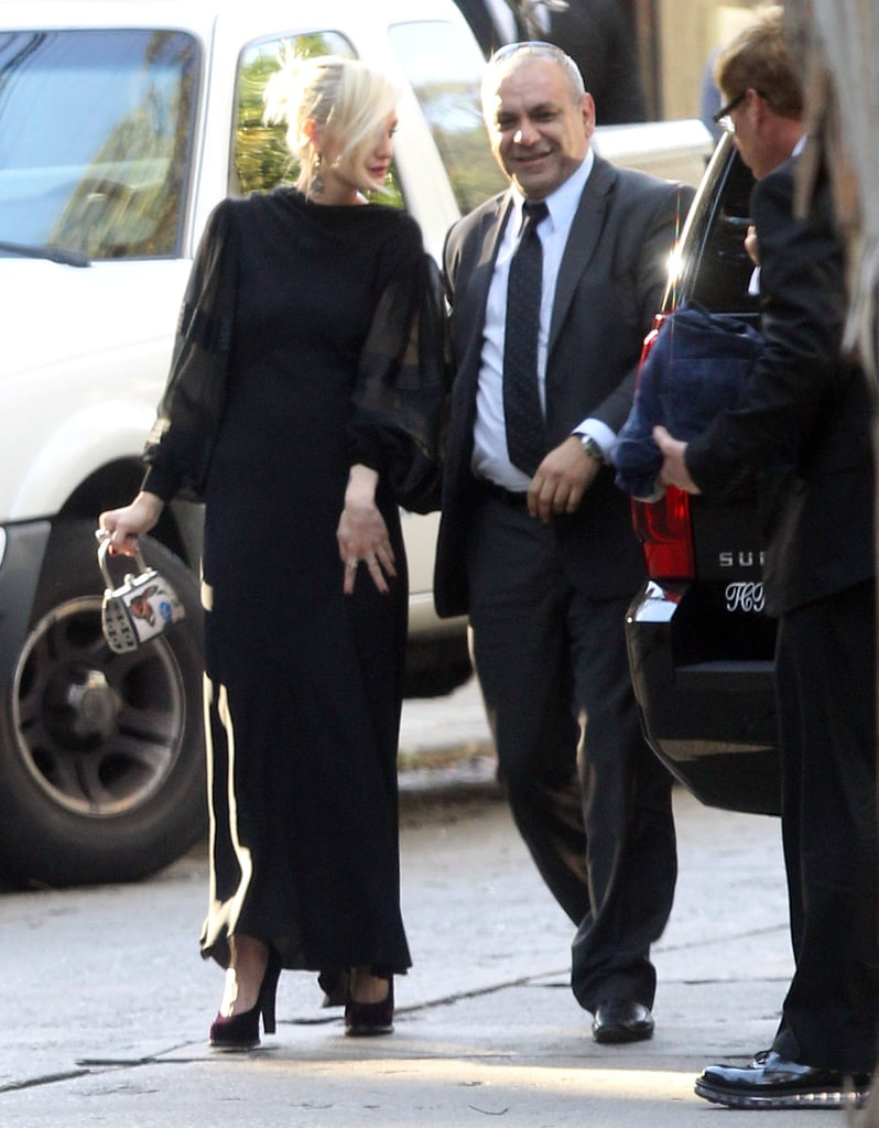 Ashlee Simpson wore a dark dress to CaCee Cobb and Donald Faison's wedding.