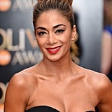 To show off her sweetheart strapless gown, Nicole swept her hair into a bun and built up that power brow for the Olivier Awards in 2015.
