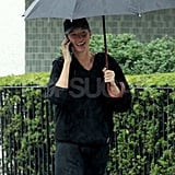 Gisele Bundchen smiled in the rain in Boston.