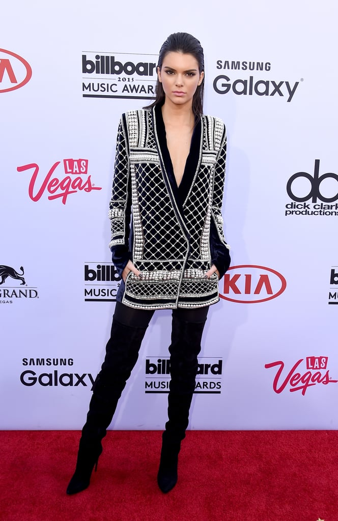 Kendall helped announce Balmain's collaboration with H&M wearing a monochromatic blazer that gave a borrowed-from-the-boys look a sexy twist.