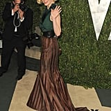January Jones makes her way into the paty.