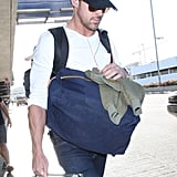 Ryan Gosling exited the airport.