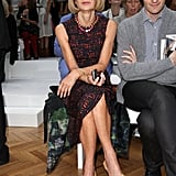 Anna Wintour showed off her signature style wearing a printed sheath, peep-toe sandals, and black sunnies at the Nicole Farhi show.