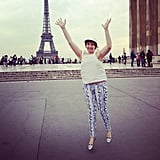 Lena Dunham jumped for joy while checking out the Eiffel Tower during Paris Fashion Week. Source: Instagram user lenadunham