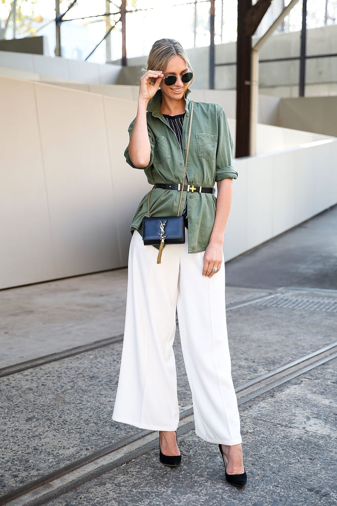 A belted blouse over wide-leg trousers