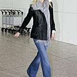 Spotted at London's Heathrow airport, Gwyneth chose a black blazer but ditched the skinny jeans for wide leg.  Get Gwyneth's airport look below.