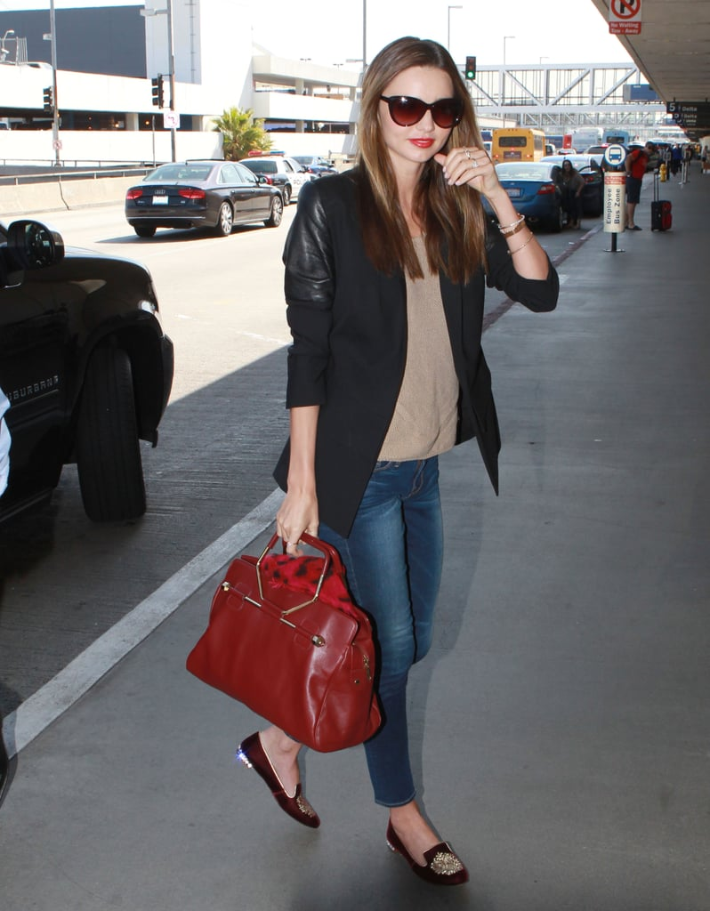 Miranda Kerr put together one of the most polished travel ensembles, relying on a leather-sleeved blazer and a sleek Viktor & Rolf tote to upgrade her jeans-and-knit combo.