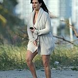Kim Kardashian covered up on the beach in Miami.