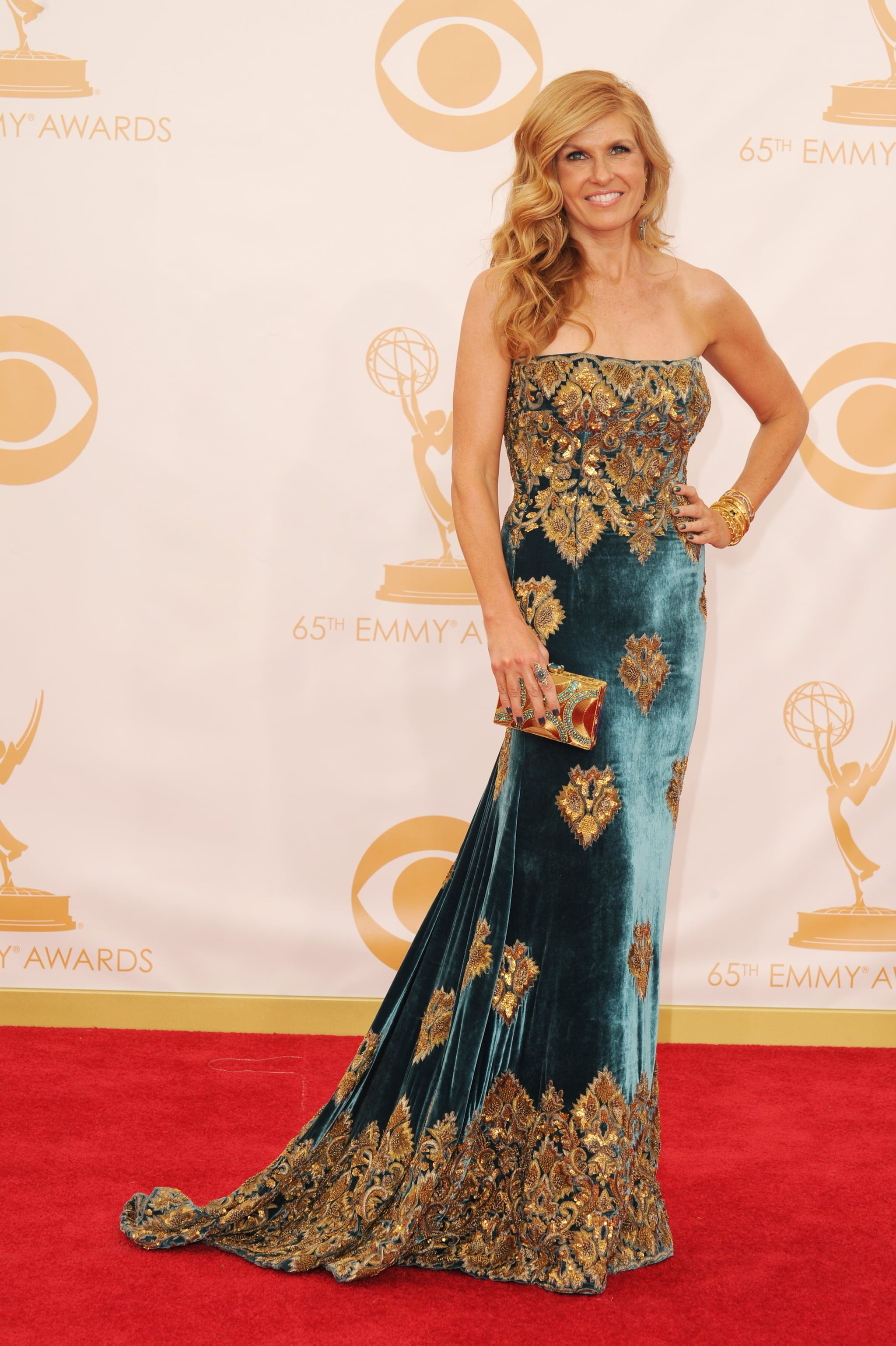 Connie Britton went for luxury in a velvet Naeem Khan Fall 2013 gown embroidered with gold and finished it off with Cathy Waterman jewels and a Stuart Weitzman clutch.