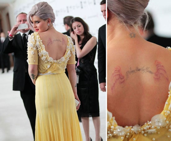 "Kelly Osbourne has multiple pieces on her back including a star on her neck and the words ""I love my mummy"" in French."
