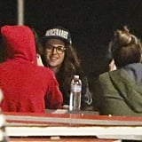Kristen smiled while grabbing dinner with her friends.