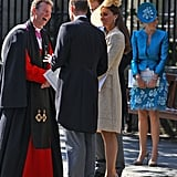 Will and Kate chat with Reverend Neil Gardner at Mike and Zara's wedding.