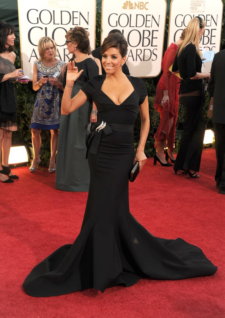 Eva Longoria is decked out in a form-fitting, bare-backed Zac Posen on the glamorous Golden Globe Awards red carpet. The Desperate Housewives star was solo on the arrivals line after her recent divorce from Tony Parker. She's rumoured to be seeing Penelope Cruz's 25-year-old brother Eduardo, though they've yet to be spotted out as a couple. Are you loving her structered look? Weigh in with all of Fab and Bella's live love it or leave it polls and stay tuned for lots more from the red carpet!