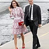 Kate punctuated her red and white Alexander McQueen dress with cherry-red heels and a matching clutch.