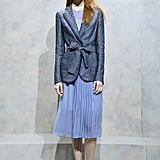 A blazer belted over a day dress.