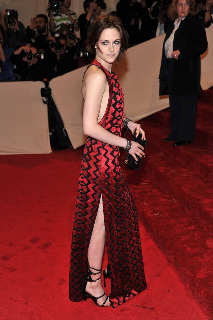 Kristen Stewart looked stunning in a sultry crimson Proenza Schouler gown, which managed to stand out even on the red carpet, at tonight's Met Gala in NYC. She pulled back her hair to expose her back in the gown, which kept her pretty covered up in the front, although it also gives a peek at her leg from the side. It's Kristen Stewart's second time at the Met Gala, though Robert Pattinson wasn't able to join her since he's overseas taking care of the Water For Elephants international press tour. What do you think of it? Weigh in on Kristen and all the rest of the 2011 Met Gala red-carpet pictures with Fab and Bella's live love it or leave it polls!