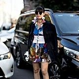 . . . While this show-goer added hers to a printed look, also at MFW.
