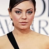 Pulling her hair back into a tight bun, Mila kept her makeup look monochromatic at the 2012 Golden Globes. She stuck to ballerina pink for her eyes, lips, and cheeks —and a sexy swipe of winged liner.