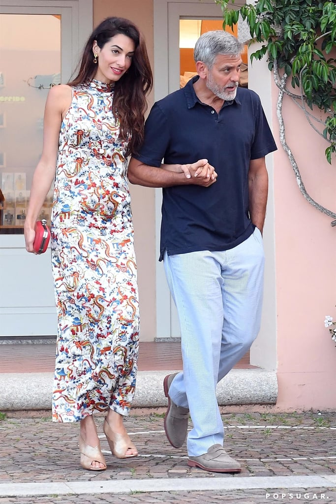 """George and Amal Clooney are feeling the love! On Monday, the couple stepped out for a romantic dinner date at Il Marino di Puntaldia in Sardinia, Italy, just two days before their twins' first birthday. George was ever the gentleman as he held Amal's hand and escorted her inside the restaurant. Amal, of course, looked gorgeous as always in a floral dress, while George kept things cool in a blue polo shirt and striped trousers.   George and Amal officially became parents when they welcomed their twins, Alexander and Ella, last year, and Wednesday marks their first birthday. The couple will also be celebrating their fourth wedding anniversary this September. Wow, what an exciting time for the Clooneys!       Related:                                                                                                           George Clooney Admits He """"Chased"""" Amal For """"Many Months"""" After They First Met"""