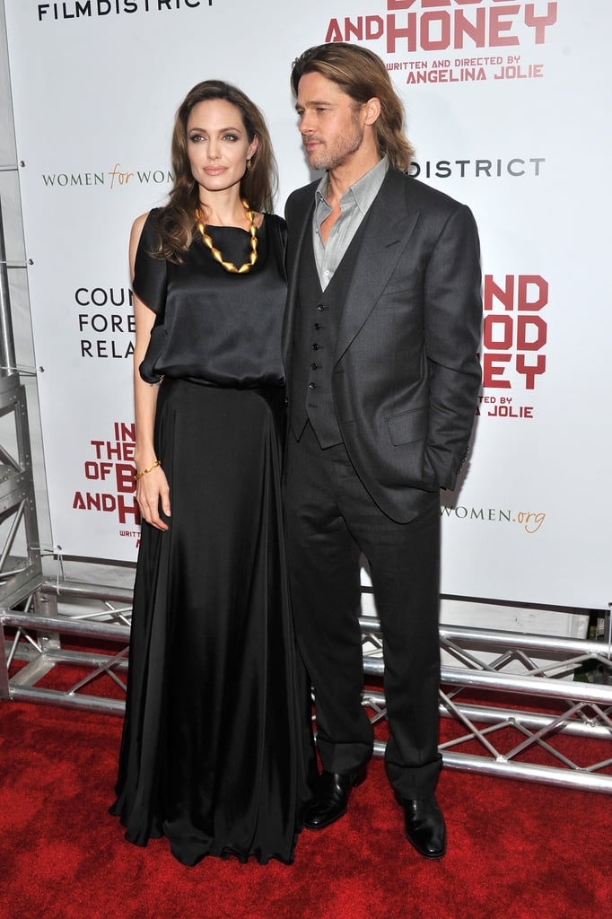 Brad Pitt was by Angelina's side for the premiere of her directorial debut, In the Land of Blood and Honey, in NYC this evening. They've had plenty of sexy moments this year, and their latest red-carpet appearance didn't disappoint. Angelina wore a glamorous black Joseph top and Ralph Lauren skirt with gold Ofira jewelry, while Brad rocked a vest and scruffy facial hair. Brad's parents were also on hand for the big event and posed with Angelina on their way into the screening. The whole family is on the East Coast while Angelina promotes her dramatic new film, and she'll continue press with more interviews tomorrow. Angelina took a break from chatting about her project to treat Pax, Shiloh, and Zahara to a movie over the weekend.