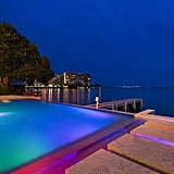 The mansion's infinity pool is embellished with neon lights.