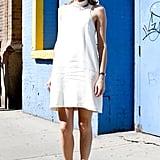 A white sheath met sexier heels for a twist on ladylike dressing.