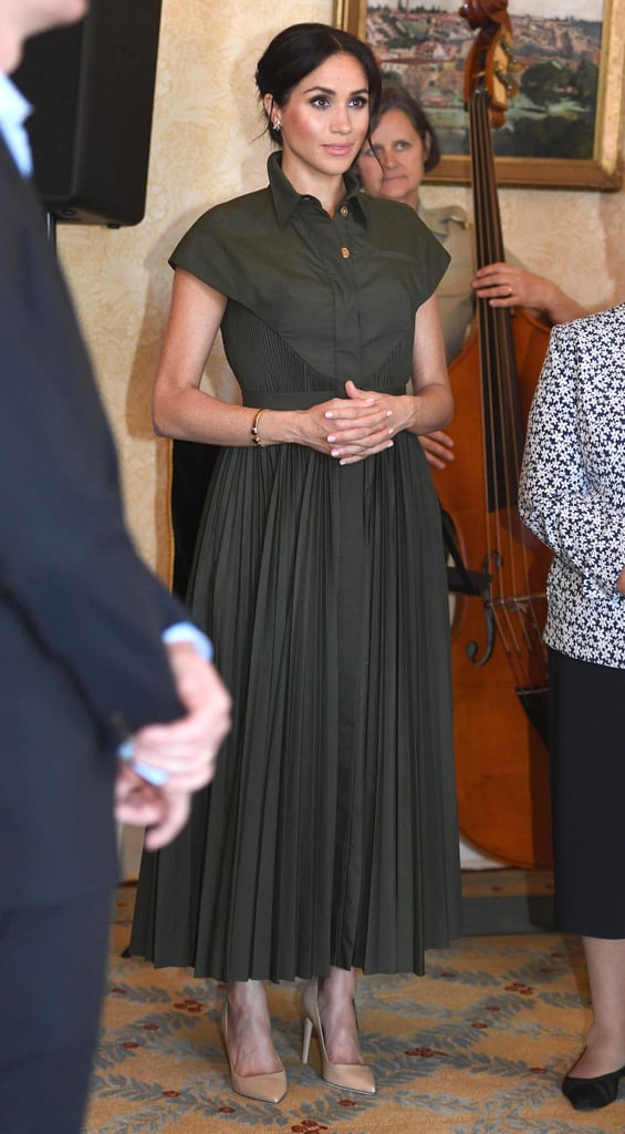 Meghan wore this pleated Brandon Maxwell shirt dress during her 2018 visit to Sydney, styling her look with neutral Tamara Mellon pumps for an afternoon reception at Admiralty House.