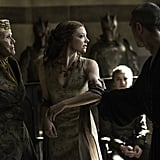 """POPSUGAR: Let's talk about Game of Thrones.  Natalie Dormer: Sure, I'm fine with telling you nothing.  PS: Well, great. So, they released a poster, and Jon Snow is obviously on it. What do you make of that?  ND: He got stabbed an awful lot. He's dead. When everyone was asking that we're like, """"he's dead."""" When you get stabbed that many times, you die.  PS: So, what do you think the poster means?  ND: Well, it's great. For the last two years, I haven't read other people's storylines. I love watching the show and the fans. I just sit down on my couch when the new season airs, and the [hums GOT opening theme]. I get excited as well. It helps with me not giving spoilers away. But after all these years, I was like, """"I want to start watching it as a fan again."""" There's so many of our cast, there's so many storylines going off on tangents, you can read just your part of the script, and not have a clue what's going on North of the Wall or down in Dorne or what Dany's up to. So that's the choice I made, because I just want to enjoy the show . . . I think some other people have done that this year in the cast. I think other people have not read other people's storylines as well, to just not know. And we sit in the hair and makeup trailer . . . and we theorize about it, speculate about it in the same way. I can't really give you my speculation, because people will — well, A. I'll get in trouble with Dan and David. And B. People might think I actually know something, and I don't know sh*t.  PS: How do you think Margaery has changed? In season five she had worked her way into the family and she was so confident, she felt like she had the upper hand. The floor kind of fell out from underneath her. She and her brother are both in captivity, and they're awaiting trial, and she's been broken in a way.  ND: She has, don't worry, I won't spoil anything, but you're completely right. To remain in King's Landing the length of time she has, and to have gone through this trauma and to be c"""