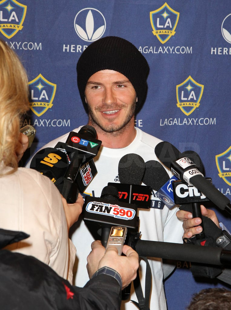 David Beckham and the LA Galaxy held a press conference earlier today in Toronto. The soccer star left LAX yesterday with his squad, while his expecting wife, Victoria, made a fashionable departure in a different direction. The Beckhams are prepping for the arrival of their first daughter later this Summer, and Victoria already started picking out baby clothes with the help of their sons. They were able to have a family weekend centered on soccer before Victoria and David took off, with her bringing the boys to a junior match as well as David's home game on Saturday. He pulled off an unbelievable soccer stunt recently while filming a Diet Pepsi commercial, and we'll see tomorrow what kind of tricks he'll use against the Canadian club. David chatted this morning about how he'd like to keep playing as long as he can, and he's also hoping to aid England's attempts to win a gold medal during the 2012 Summer Olympics.