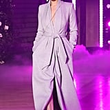 Walking in Brandon Maxwell's show wearing a lavender robe by the designer.