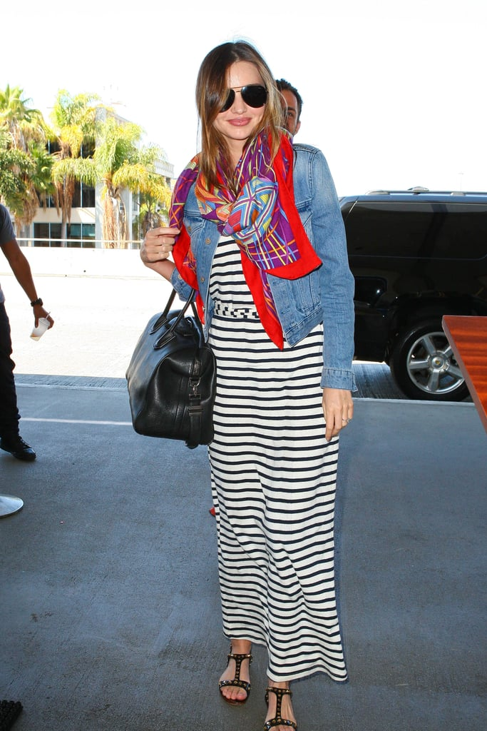 Miranda Kerr knows the trick to travelling: always take a scarf. Lightweight and easy to layer when the flight gets cool, you simply can't board without it.