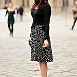 Julia Restoin-Roitfeld styled the perfect play on ladylike in a printed midiskirt.