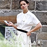 Katie Holmes struck a sassy pose while listening to music on set.