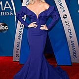 Carrie Underwood wore an off-the-shoulder royal blue Fouad Sarkis Couture dress, Giuseppe Zanotti shoes, Butani earrings, and rings from Anabela Chan and Hearts on Fire.