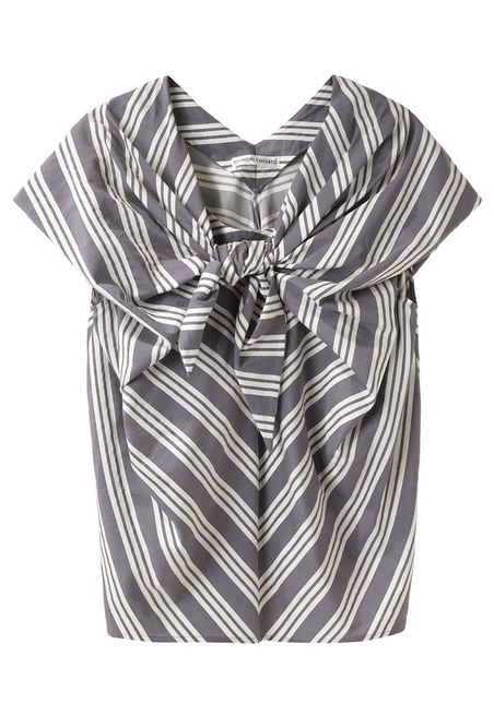 The stripes, plus exaggerated tie front, provide a playful take on a nautical vibe. Tsumori Chisato Striped Blouse With Tie ($438)