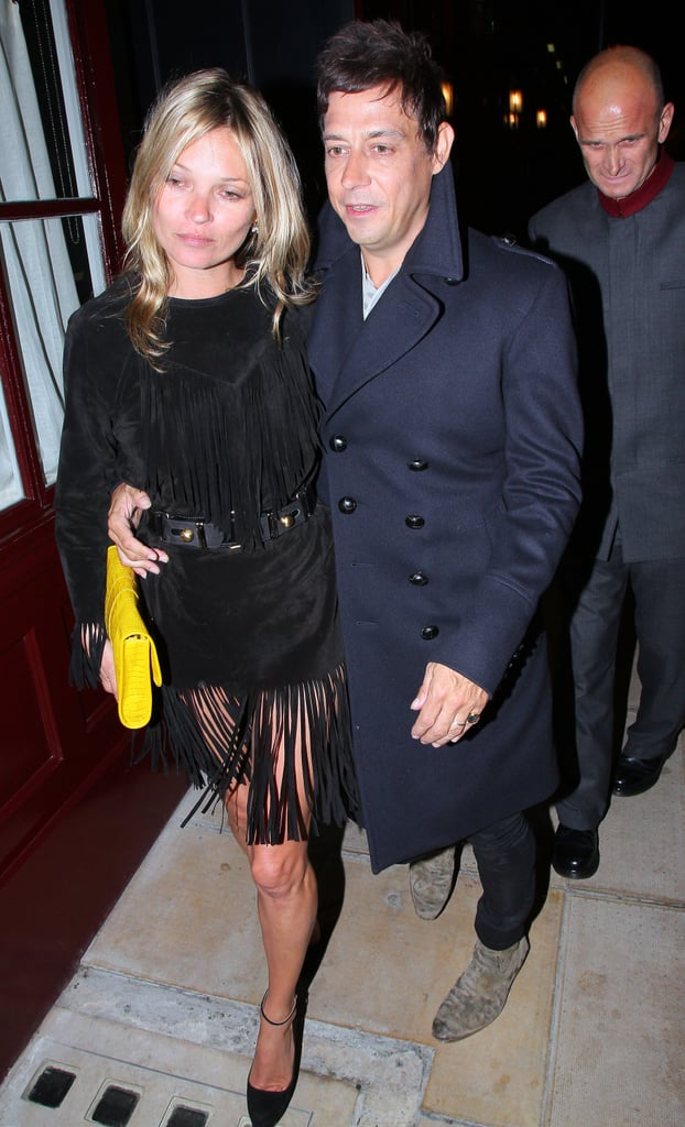 Kate Moss wore a black dress with a fringed bottom to party in London with Jamie Hince.