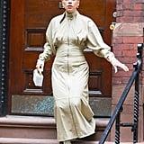 Wearing a Zimmermann dress with Schutz boots and a Mark Cross bag.