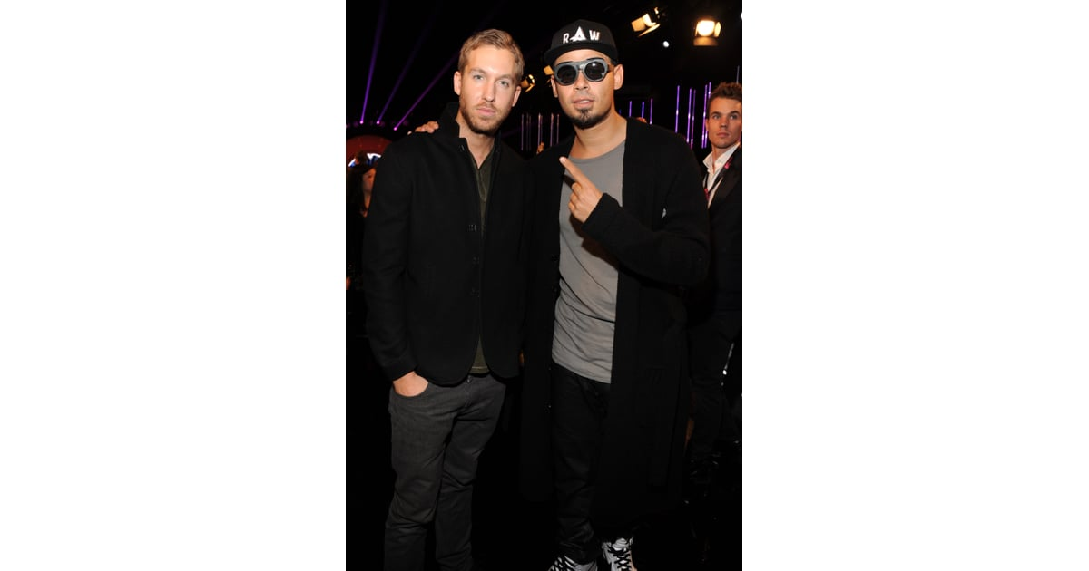 calvin harris and dj afrojack posed together during the