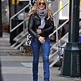 With Her Winter Staples: A Leather Jacket and Scarf