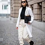 Ground your Winter whites with pointed-toe boots and a turtleneck thin enough to tuck into the waistband of your pants.