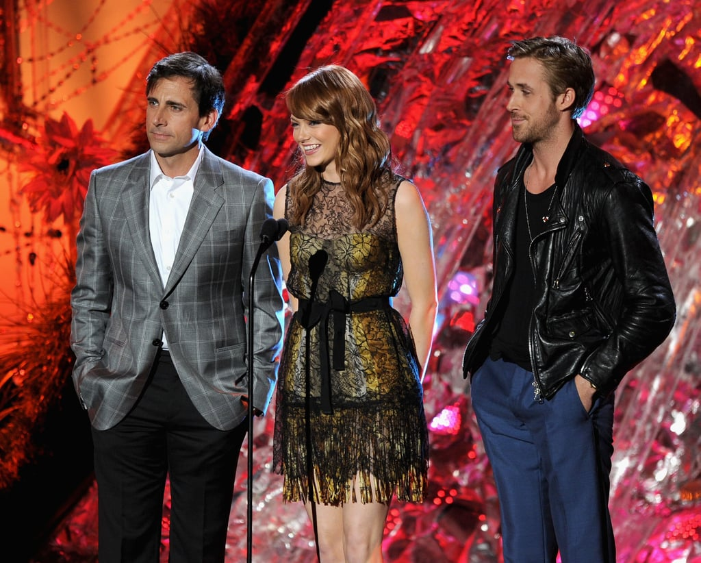 Crazy, Stupid, Love costars Ryan Gosling, Emma Stone, and Steve Carell took the stage together to present the best villain golden popcorn at tonight's MTV Movie Awards. The statue went to Tom Felton for his work in Harry Potter and the Deathly Hallows Part I, though so far it's the Twilight crew who are cleaning up. Ryan Gosling has had his own epic moment at the show in the past when he and then-girlfriend Rachel McAdams won for best kiss, which just went to Robert Pattinson and Kristen Stewart for the third year running. Emma was still wearing the cute Bottega Veneta dress she sported on the red carpet as she was flanked by her handsome leading men. Keep track of all the 2011 MTV Movie Awards winners on BuzzSugar as the show goes down!