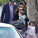 Isla Fisher, Sacha Baron Cohen, Elula Cohen, and Olive Cohen took a walk in Sydney.