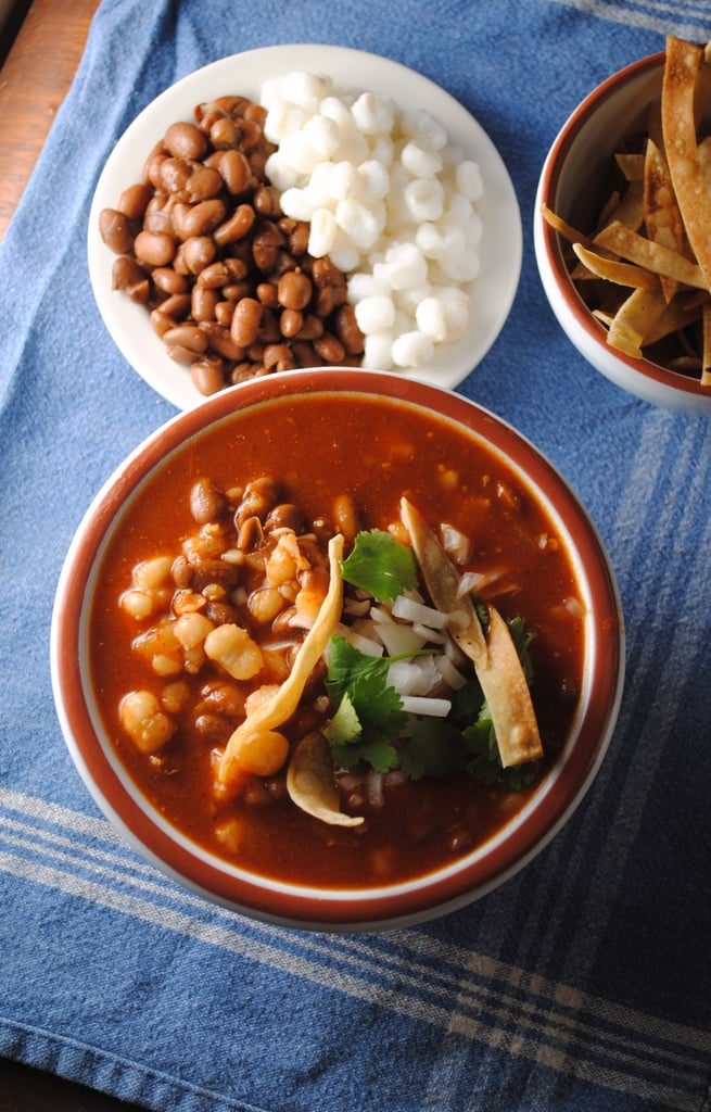 A Mexican vegetarian staple, pozole de frijol is made with hominy, tomatoes, oregano, and pinto beans, for a twist on a classic Latin stew.