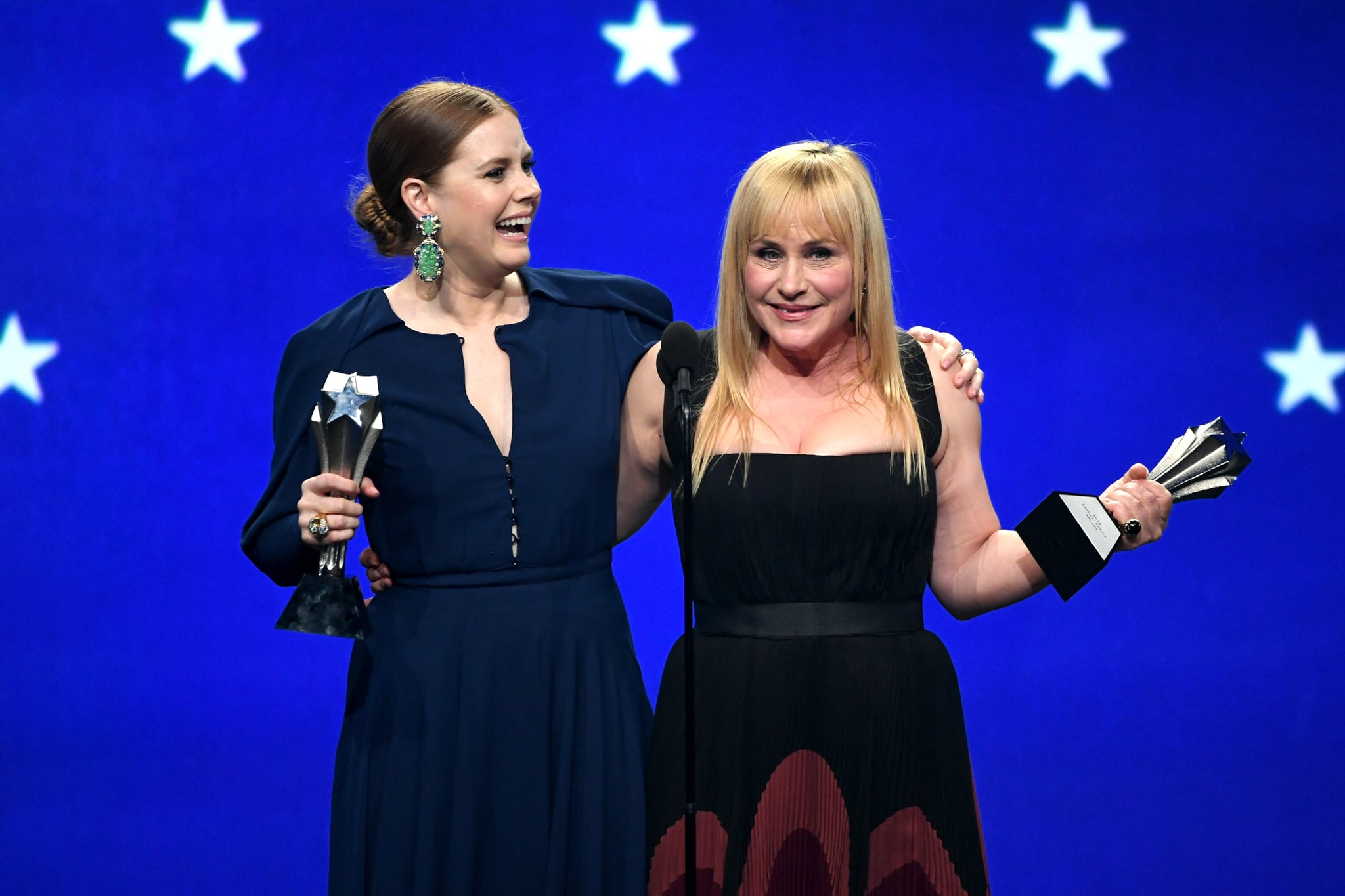 SANTA MONICA, CA - JANUARY 13: Amy Adams (L) and Patricia Arquette, co-winners of the Best Actress in a Limited Series or Movie Made for Television award (Adams for 'Sharp Objects' and Arquette for 'Escape at Dannemora') accept their awards onstage during the 24th annual Critics' Choice Awards at Barker Hangar on January 13, 2019 in Santa Monica, California. (Photo by Kevin Winter/Getty Images for The Critics' Choice Awards)