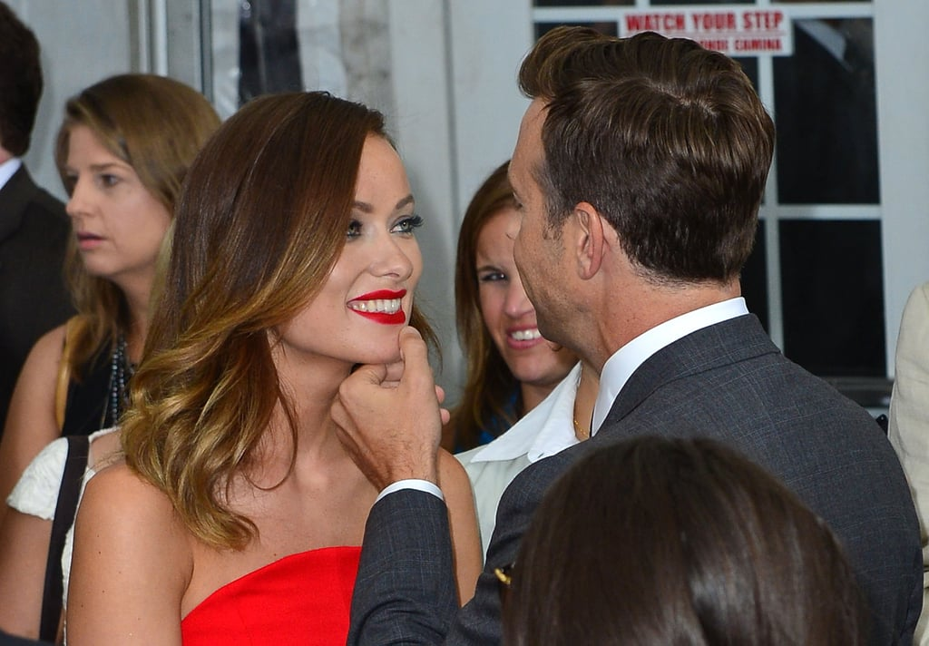 How's this for adorable? Jason Sudeikis helped Olivia Wilde keep her lipstick intact at the NYC premiere of We're the Millers in August 2013.