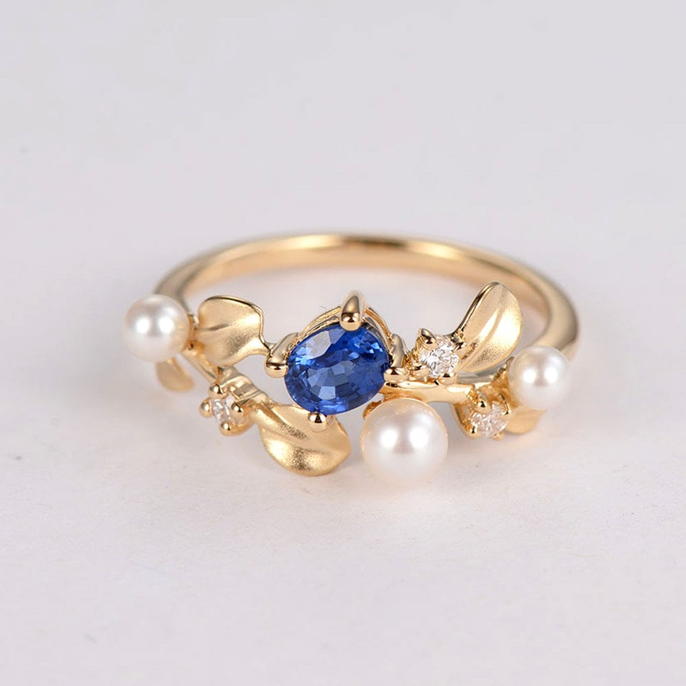 Top A mix of sapphire and pearls makes for the most unique engagement  RK08