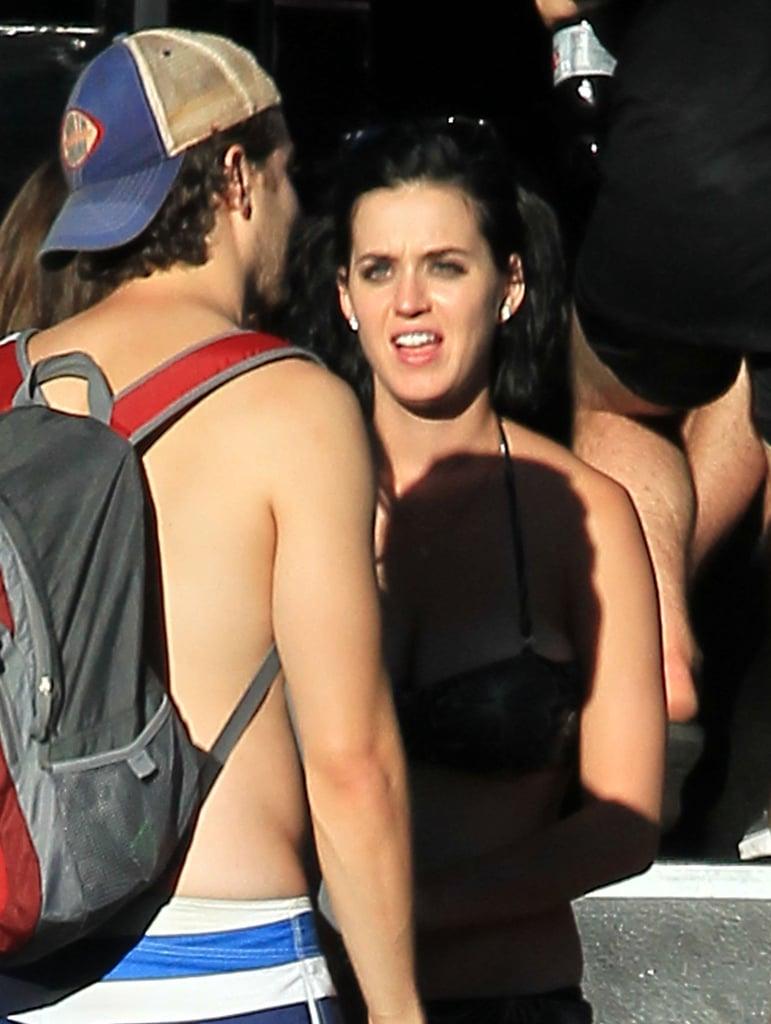 Katy Perry talked with friends.