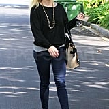Reese Witherspoon paired her skinny jeans with booties.