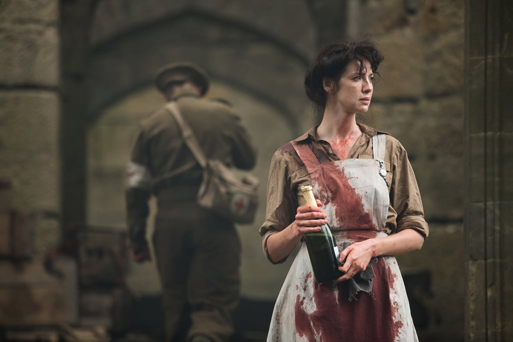 Claire flashes back to her time as a nurse in the war. Courtesy of Starz